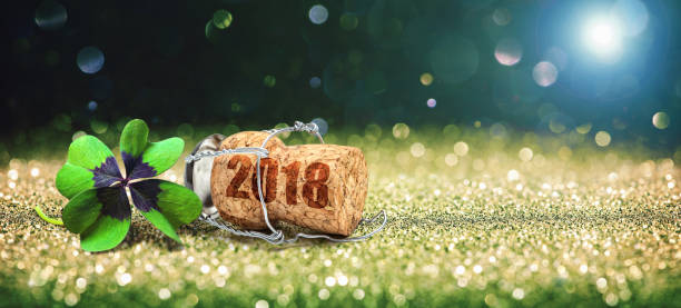 Greeting card with four leaf clover and champagne cork stock photo