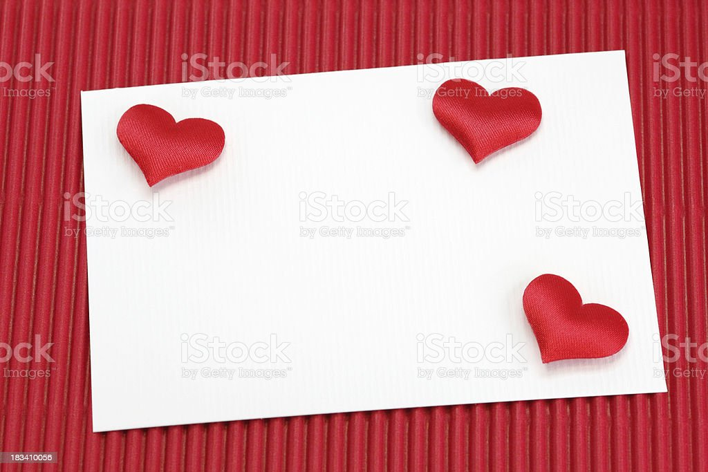 greeting card with hearts on red background royalty-free stock photo