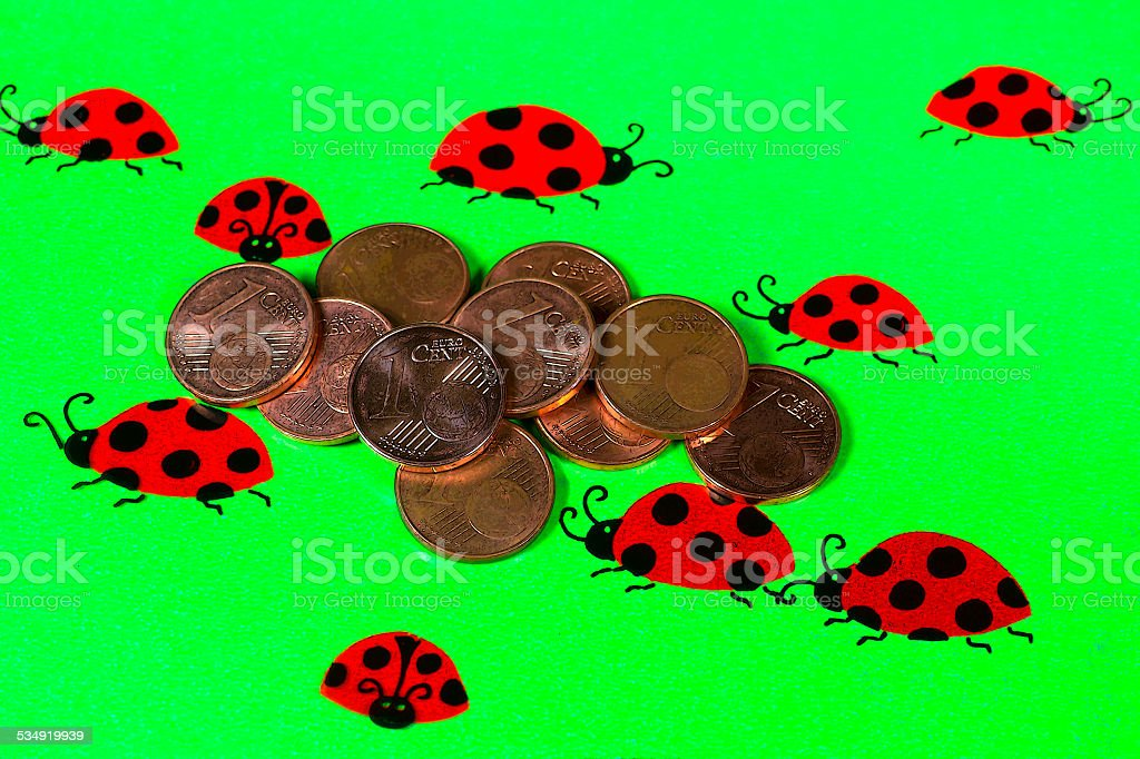Greeting Card With Ladybirds And Cent Coins Stock Photo
