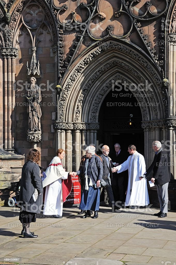 Greeting congretation at Cathedral, Lichfield. stock photo