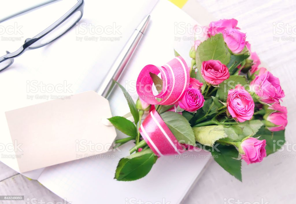 Greeting flowers bouquet present with tag. stock photo