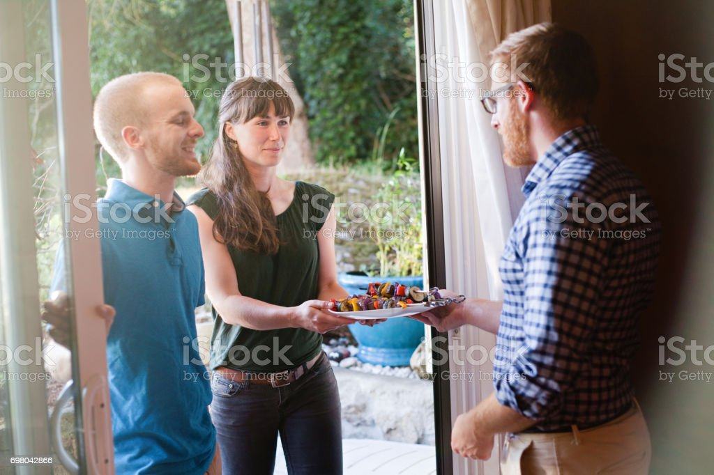 Greeting Friends at the Door stock photo