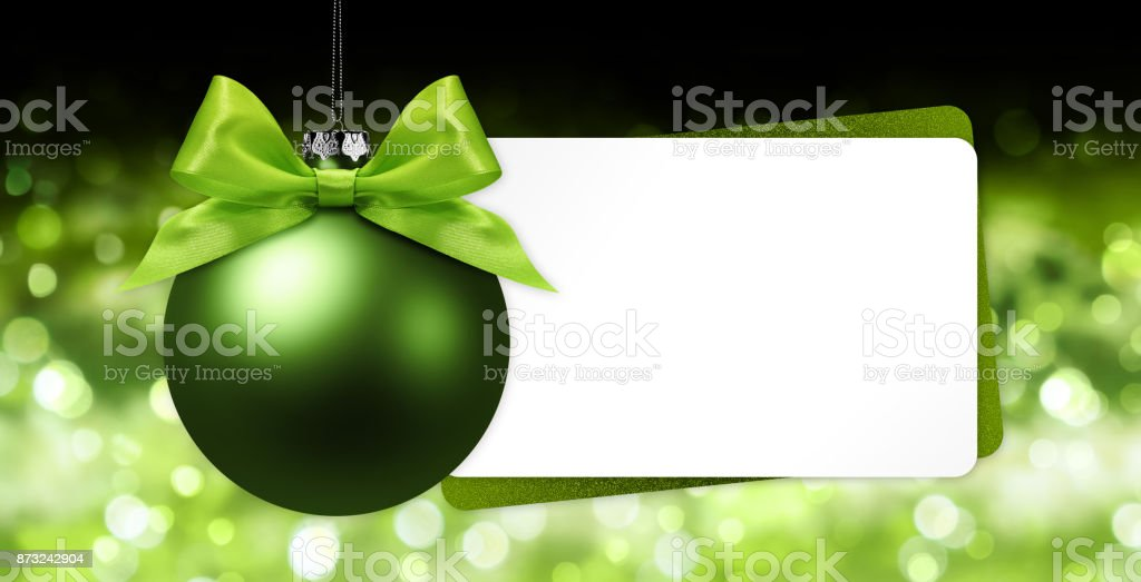 greeting gift card with green christmas ball on blurred lights background white template copy space royalty