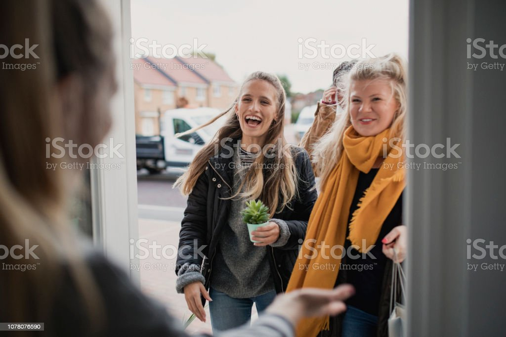 Greeting Guests at Housewarming Party stock photo