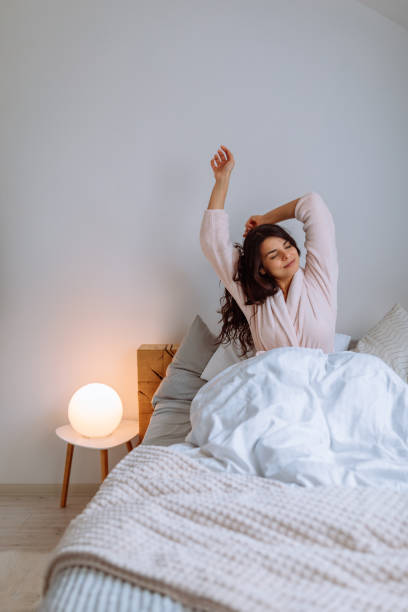 Greeting the new day with open arms stock photo