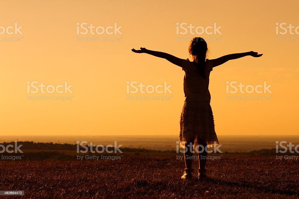 Greeting the sunset stock photo