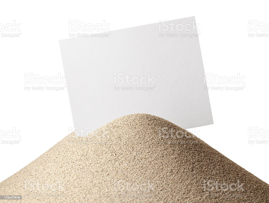 Greetings from the sea. Small sand dune with blank postcard/photo. royalty-free stock photo