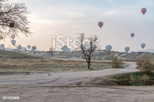 istock Göreme sunrise and balloon take off in mist 531903959