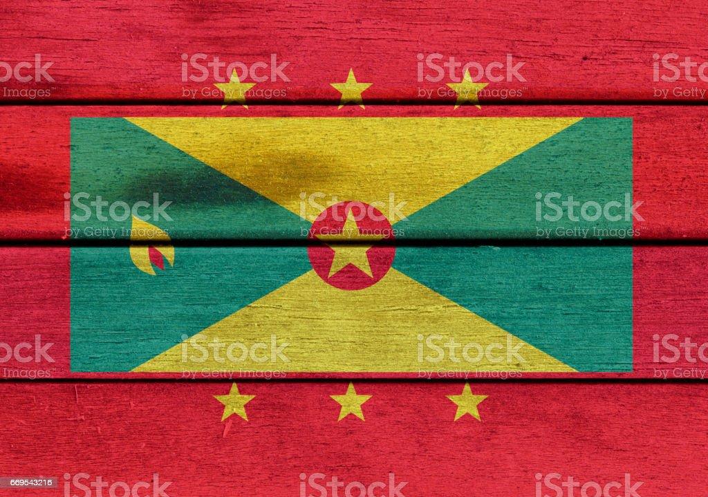 Grenada flag on a wood stock photo
