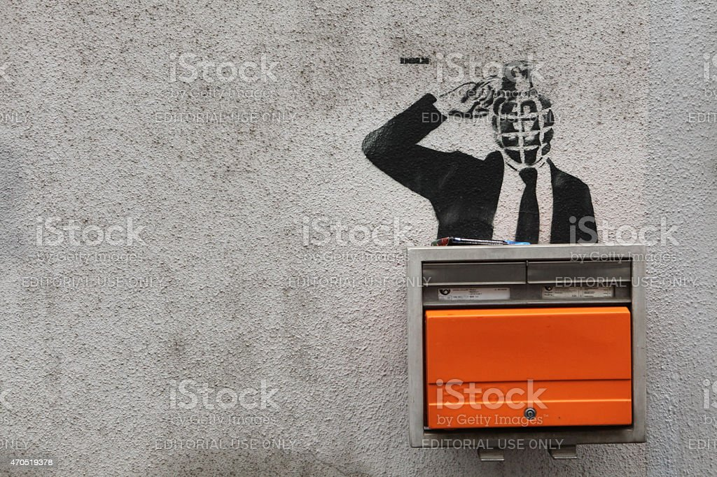 Grenade-headed person blowing his head up stock photo
