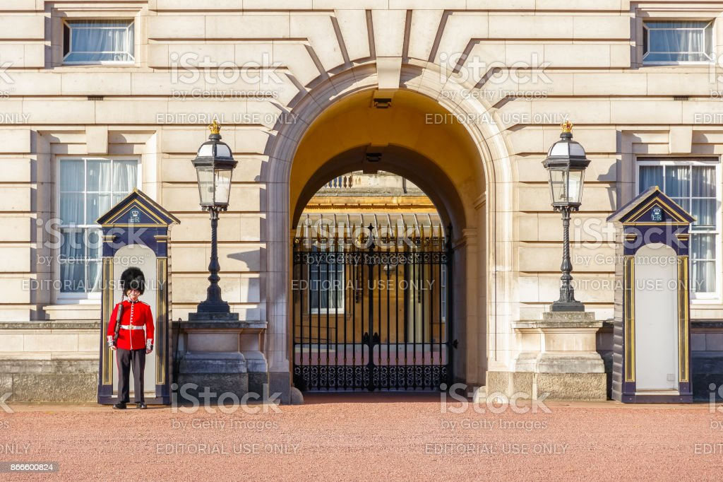 A Grenadier Guard on duty and two sentry boxes outside Buckingham Palace in London stock photo