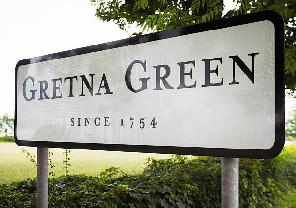 gretna green village entrance sign - ortsschild stock-fotos und bilder