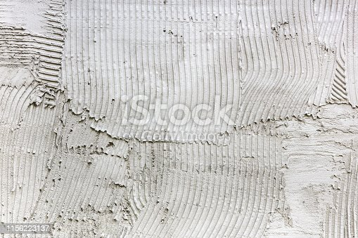 istock grey adhesive plaster stripes on wall. construction background 1156223137