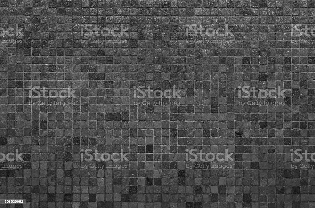 Grey and black mosaic wall texture and background stock photo