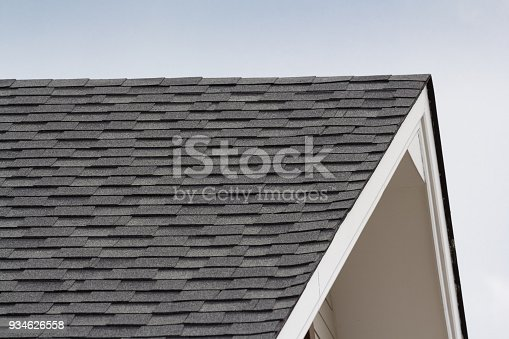 istock grey and black roof shingles of house 934626558