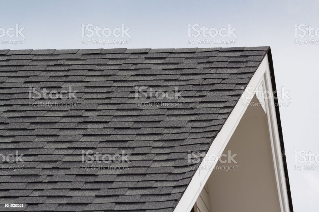 grey and black roof shingles of house stock photo
