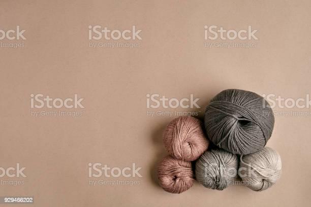 Grey and brown knitting wool and knitting needles on beige background picture id929466202?b=1&k=6&m=929466202&s=612x612&h=0yk9simncunzqrepcb1djh 9jsdrdjhsr44lxev tiy=