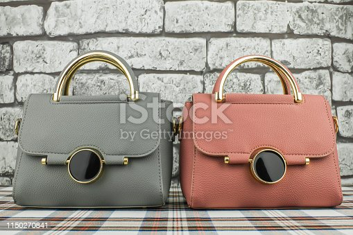 istock Grey and pink bags 1150270841