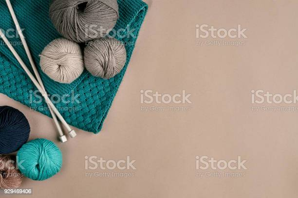 Grey and turquoise knitting wool and knitting needles on beige top picture id929469406?b=1&k=6&m=929469406&s=612x612&h=hlsirb5u3qvawt8bq3ss63qztalhidseddfy8vkijlg=