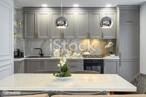 istock Grey and white luxury kitchen in modern style 1282908039