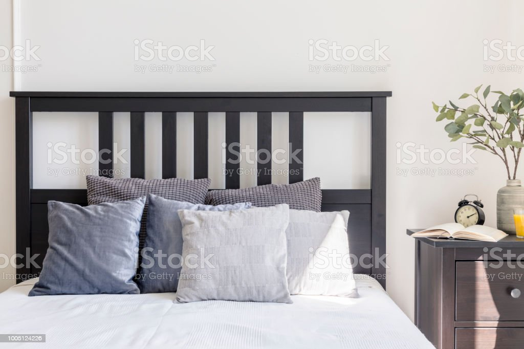 Grey And White Pillows On Bed With Black Headboard In Simple Bedroom Interior Real Photo Stock Photo Download Image Now Istock