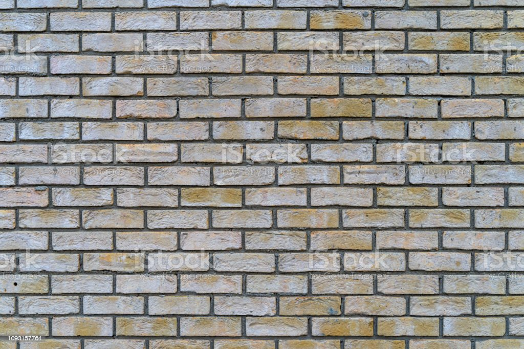 Grey and yeallow rustic brick wall - high quality texture / background