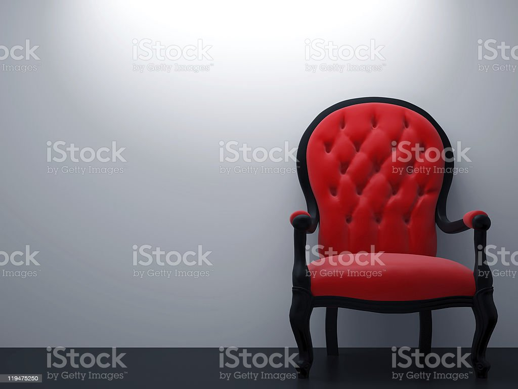 A grey apartment wall with an elegant gothic style red chair royalty-free stock photo