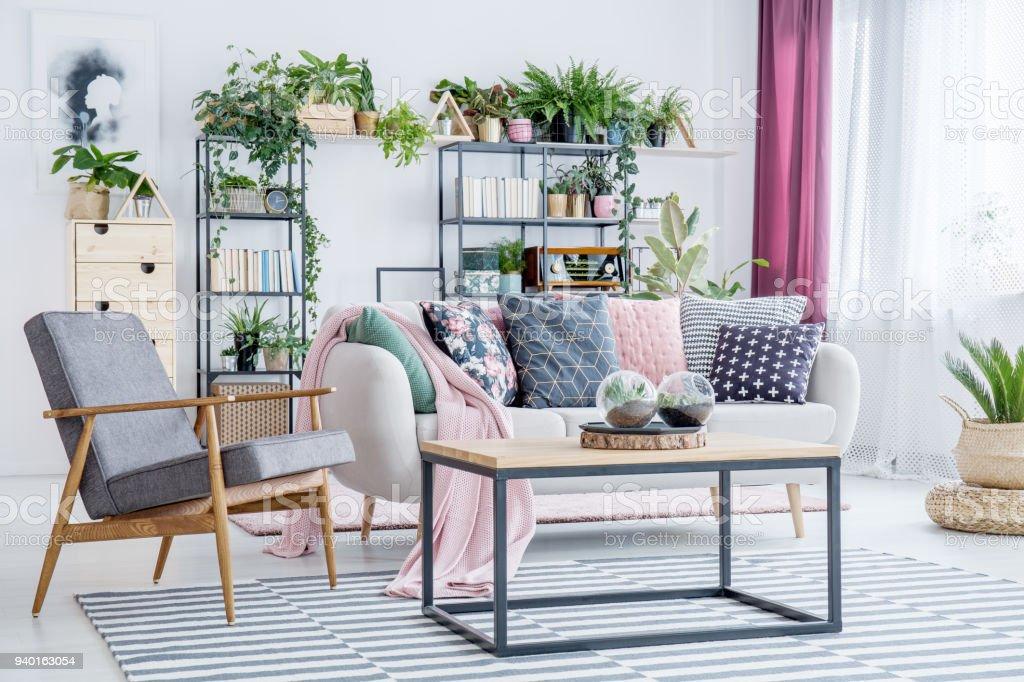 Grey armchair in living room стоковое фото