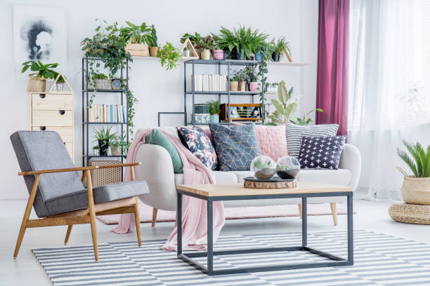 grey armchair in living room - home decor boho imagens e fotografias de stock