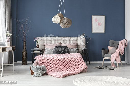 istock Grey armchair with pink blanket 846742328