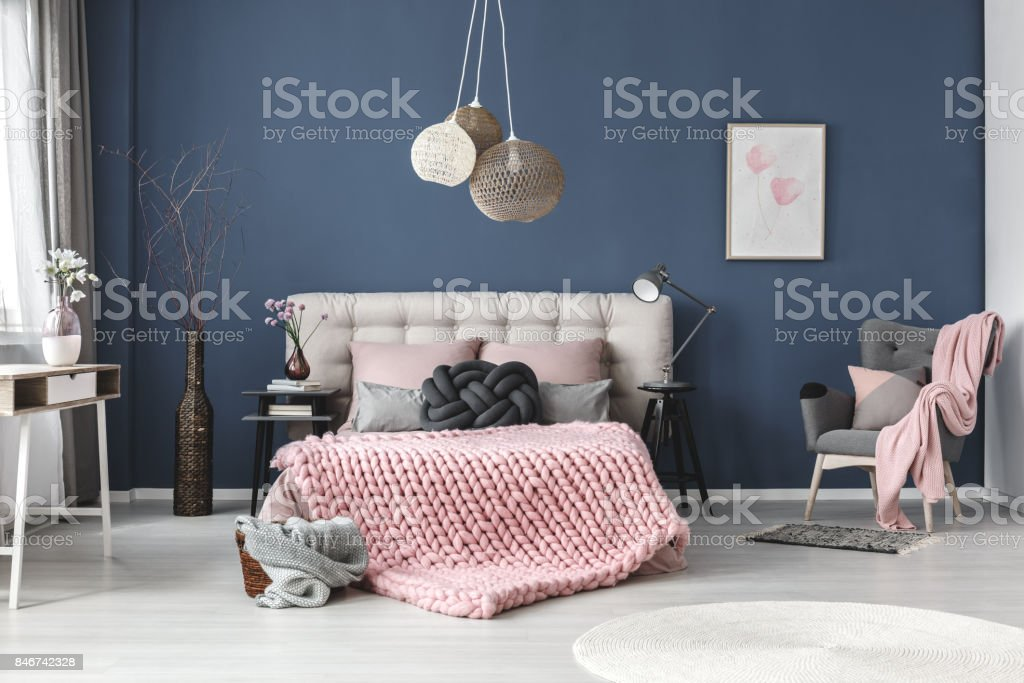 Grey armchair with pink blanket stock photo