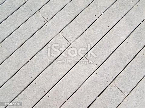grey artificial wood decking boards or lumber on ground