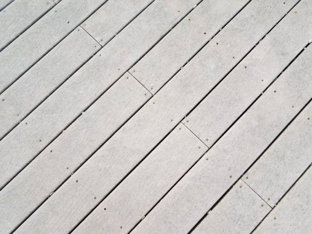 grey artificial wood decking boards or lumber stock photo