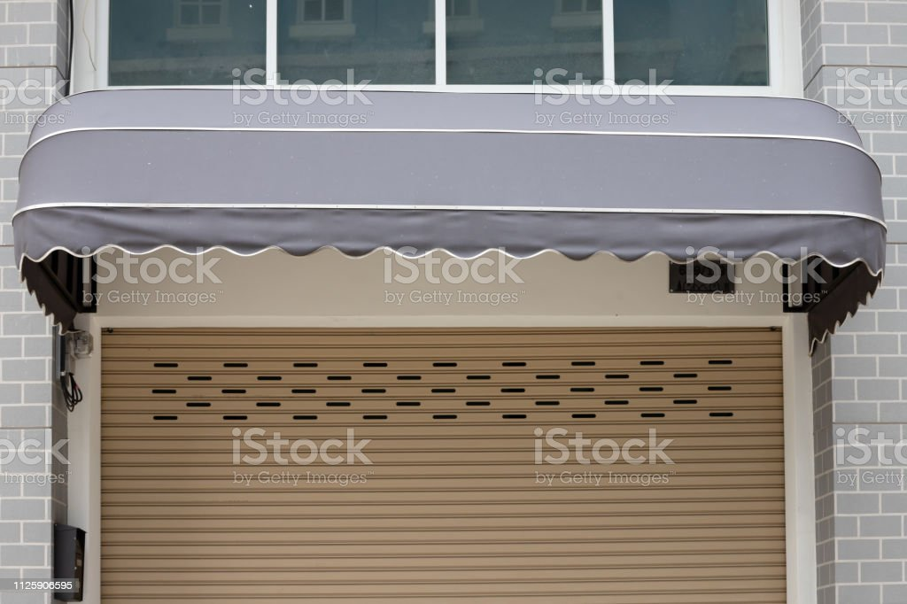Grey Awning Canvas Shading Over Steel Shutter Door Of Close Shop Stock Photo Download Image Now Istock