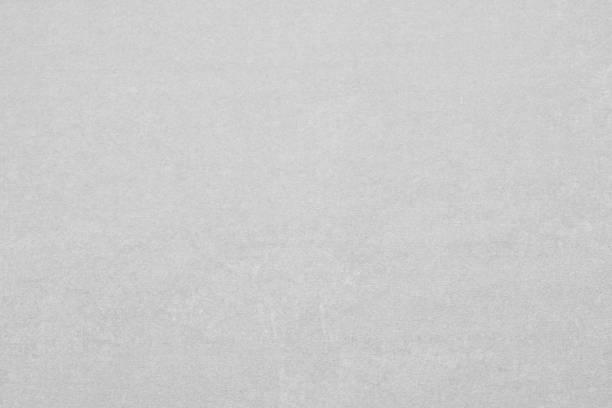 Grauer Hintergrund mit leichten Strukturen. Textur mit ungleichmäßigen leichten Strukturen. Gestalterischer Hintergrund. – Foto