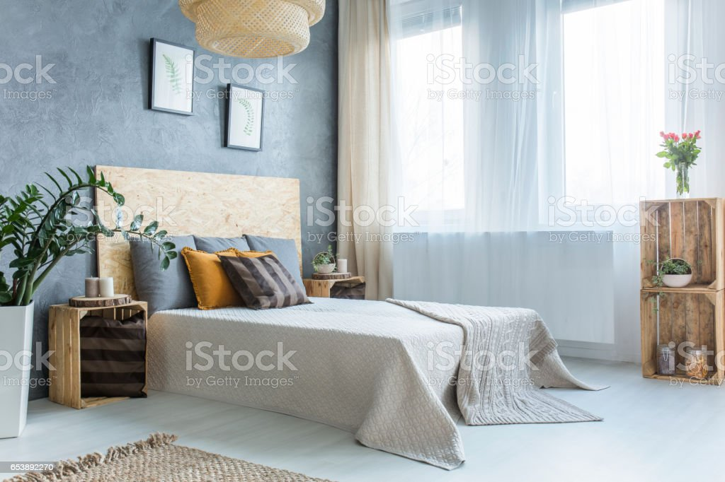 Grey bedroom with bed