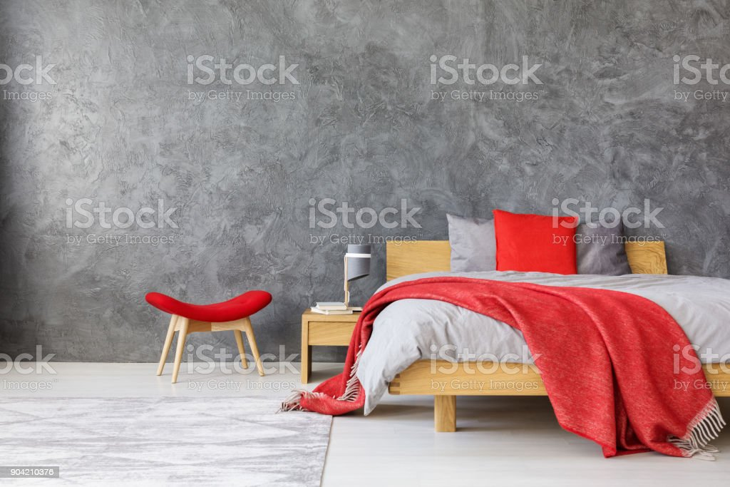 Grey bedroom with red accents stock photo