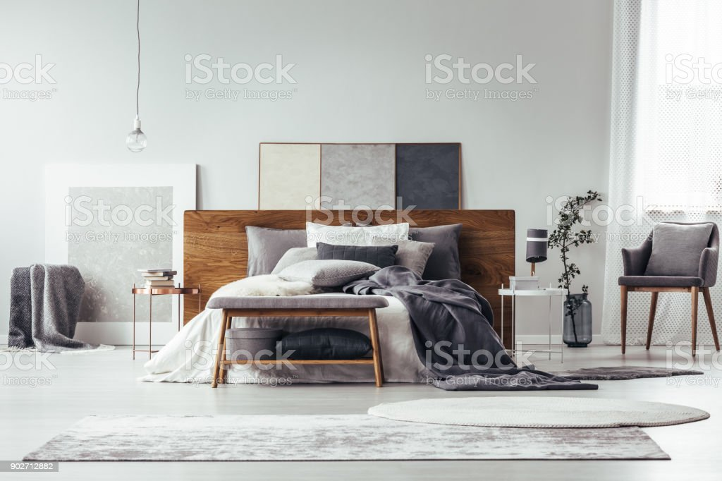 Grey bedroom with simple painting stock photo