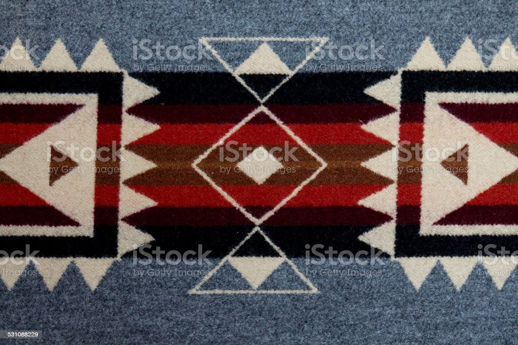 Grey, black and white Navajo blanket with horizontal lines stock photo