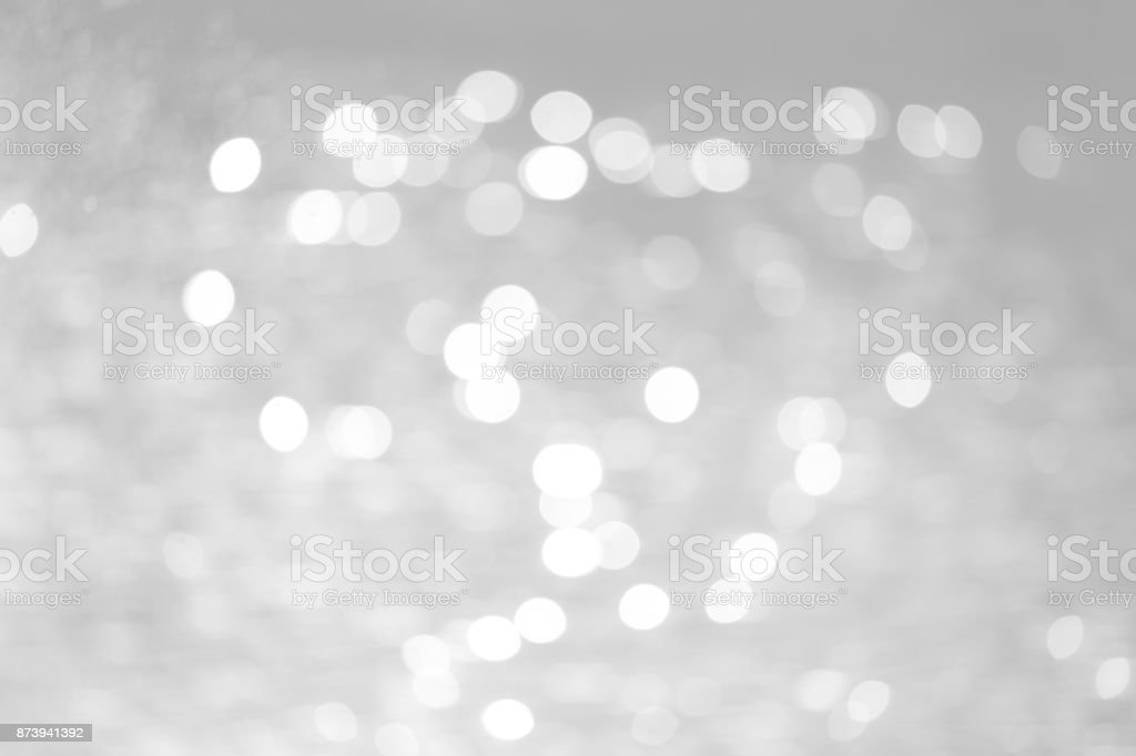 Grey bokeh with white color abstract background can be use as wallpaper, Christmas card background or new year card background. The background show light bokeh which on defocused light. stock photo