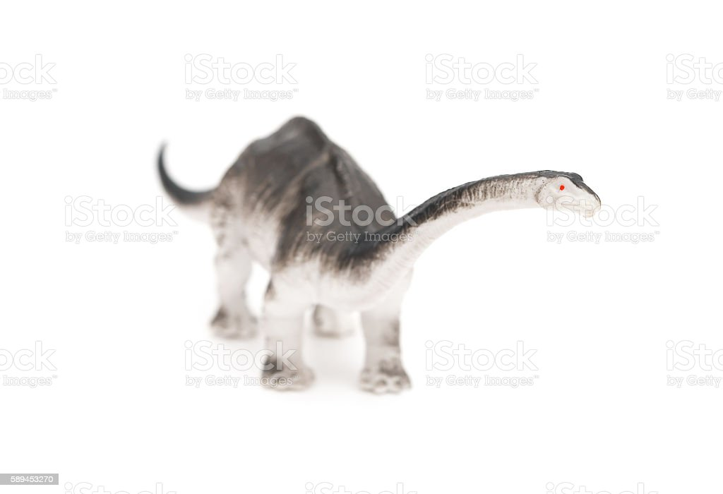 grey brachiosaurus toy on a white background stock photo