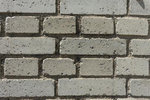 973649382 istock photo grey brick wall 828107056