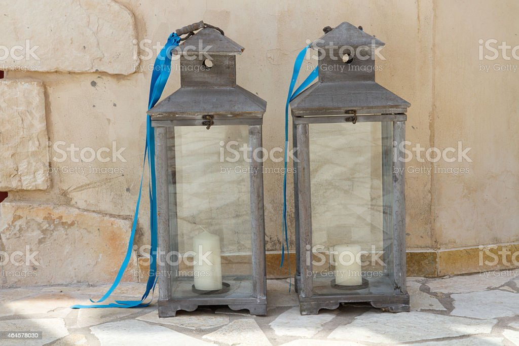 grey candle laterns with blue ribbon stock photo