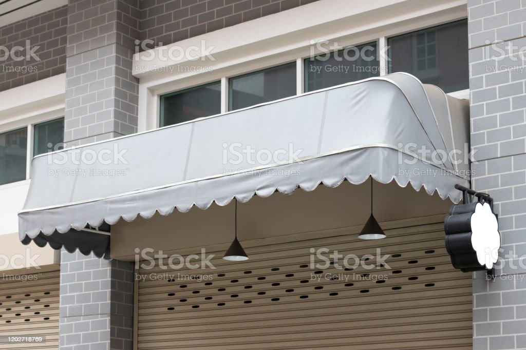 Grey Canvas Awning Over The White Shutter Door Of Shop With Blank Mock Up Stock Photo Download Image Now Istock