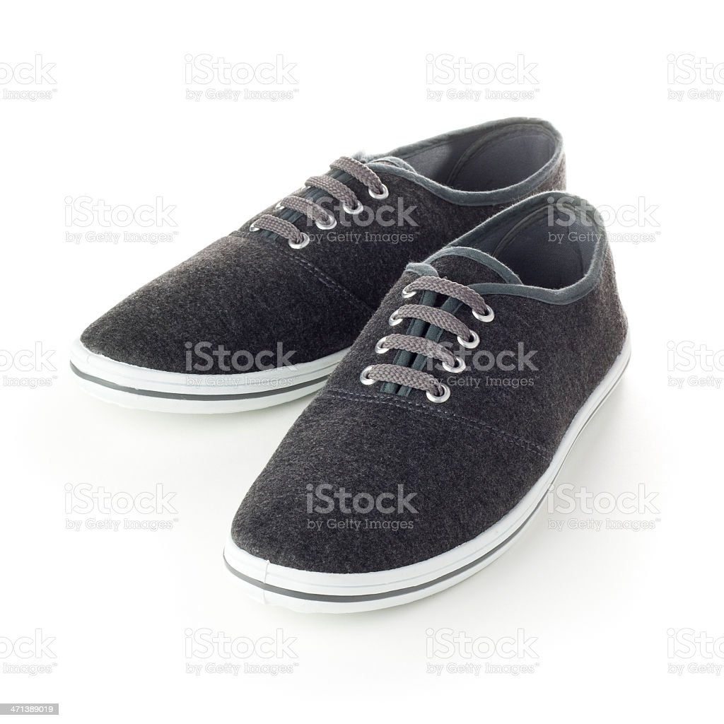 Grey canvas deck shoes isolated on a white background royalty-free stock photo