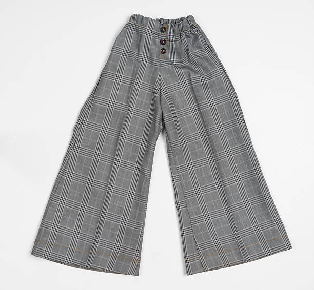 Grey chequered children's pants on white background stock photo