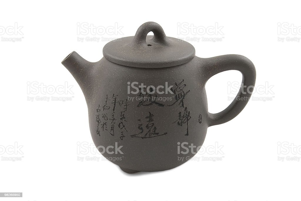 grey chinese teapot with hieroglyphic ornament royalty-free stock photo