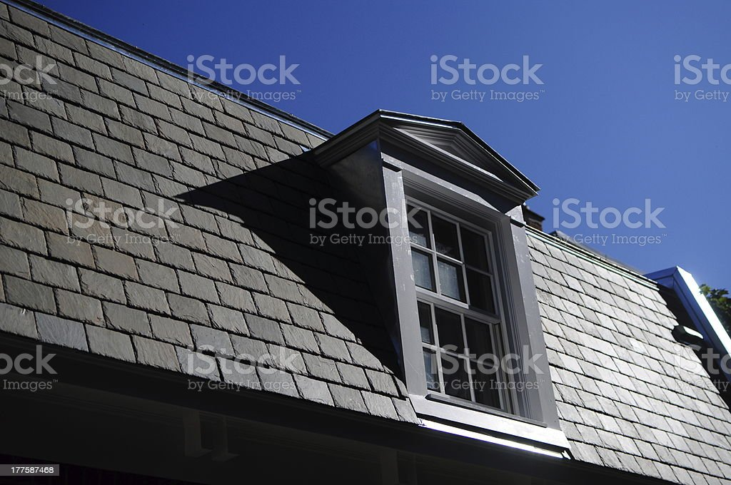 Grey clay roof with white painted window Montreal Quebec Canada royalty-free stock photo