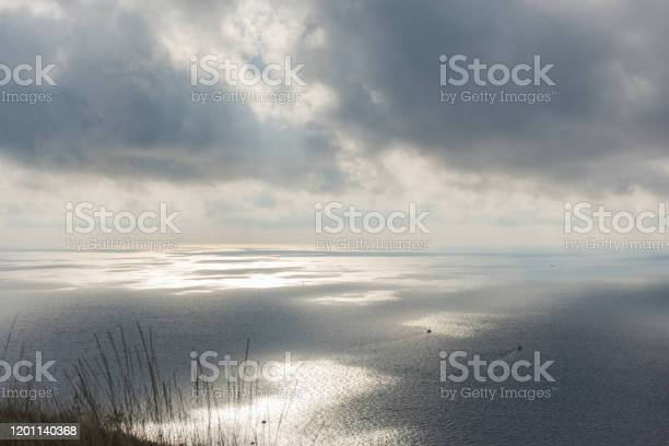 Photo of Grey clouds over the sea