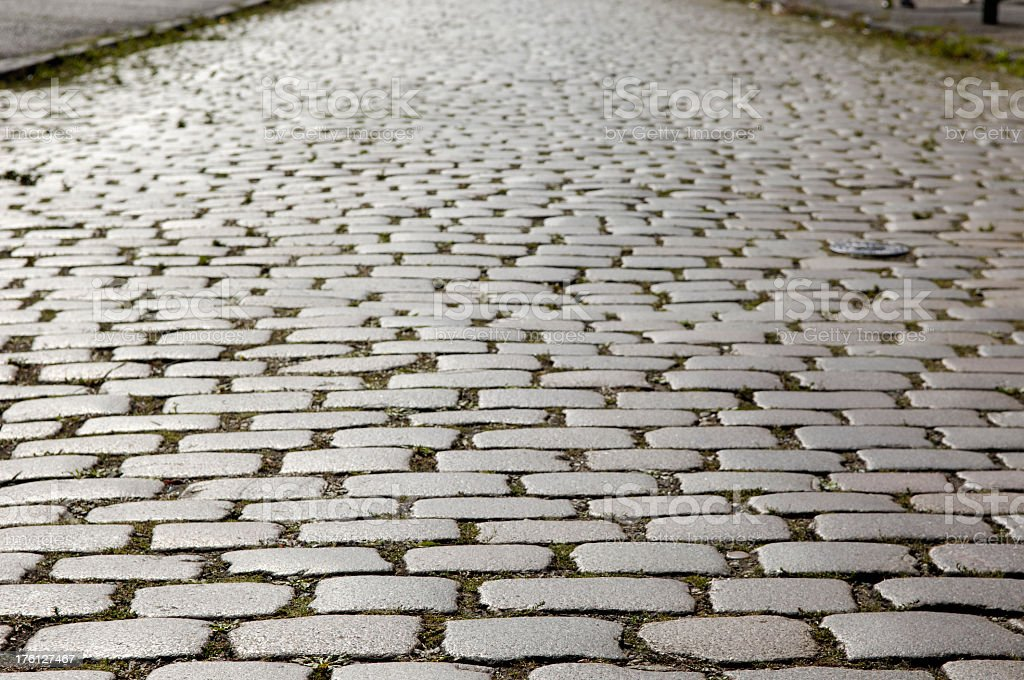 Grey cobblestone with brown in-between the cracks stock photo
